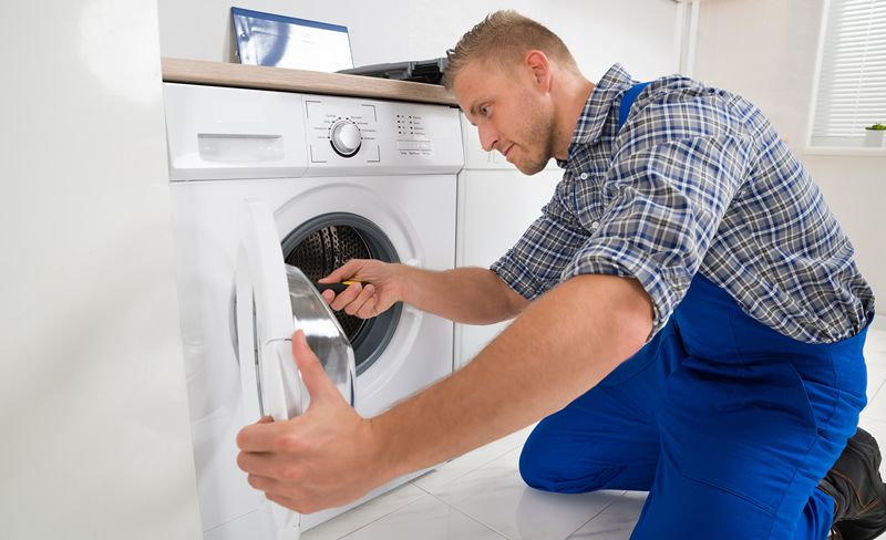 technician installing washing machine